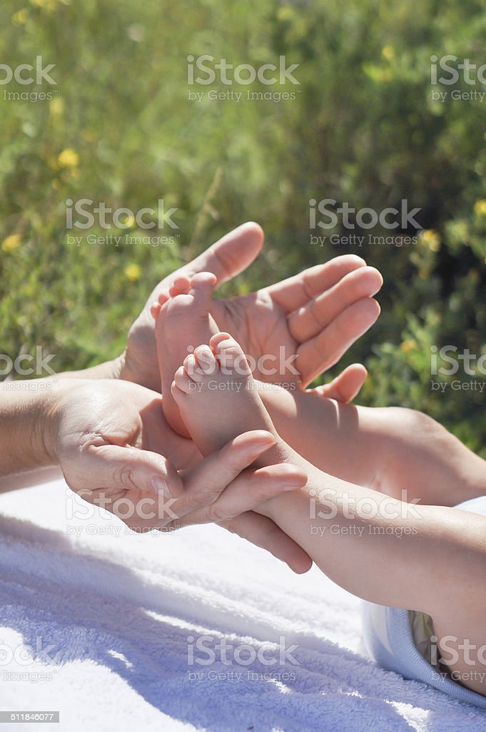 hands and feet stock photo