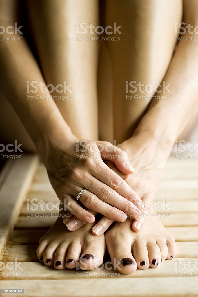 Hands and Feet, woman in sauna. royalty-free stock photo