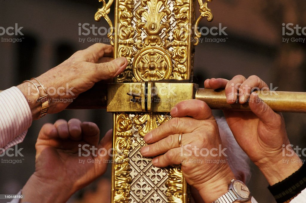 hands and gold cross stock photo