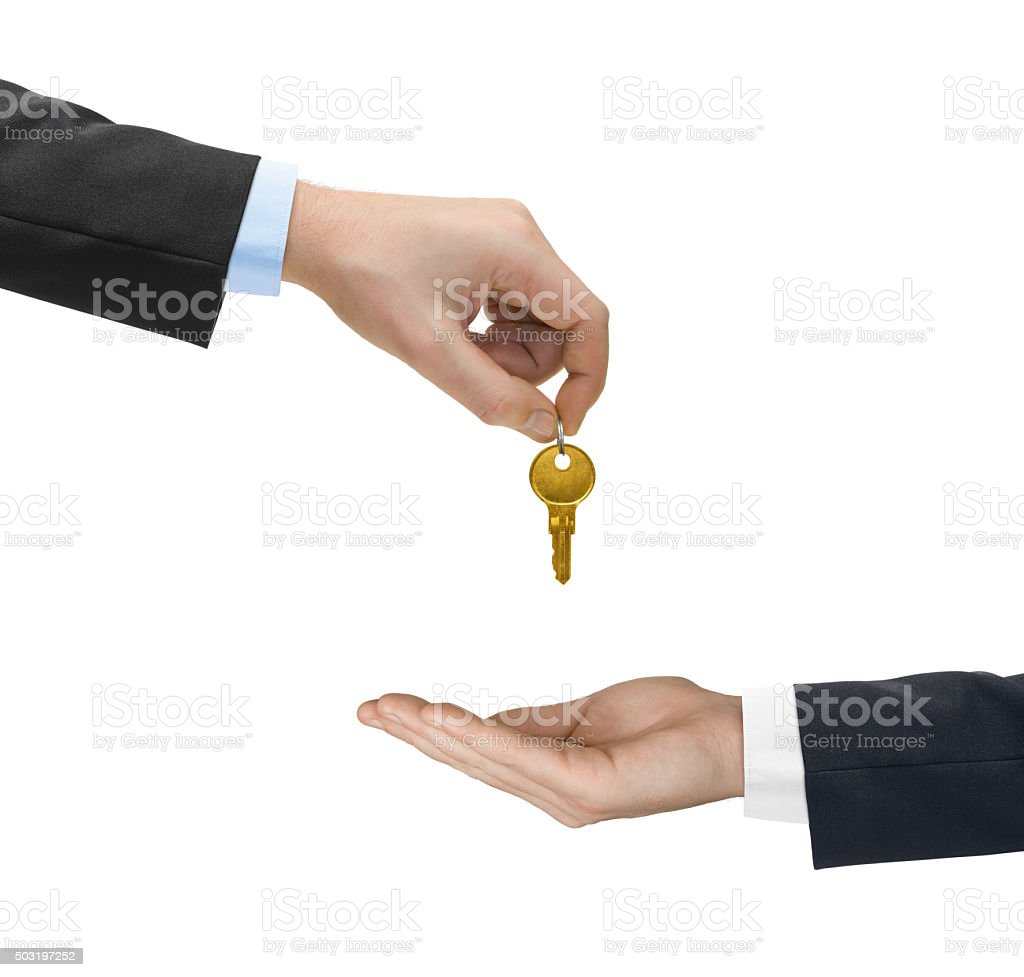 Hands and golden key stock photo
