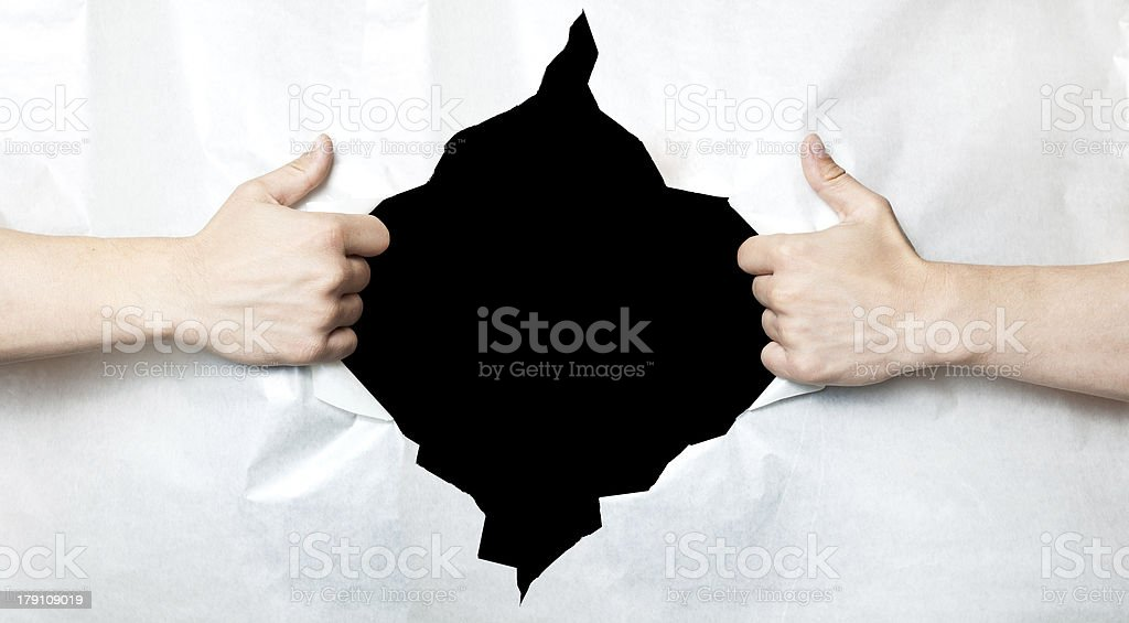 Hands and hole in paper stock photo