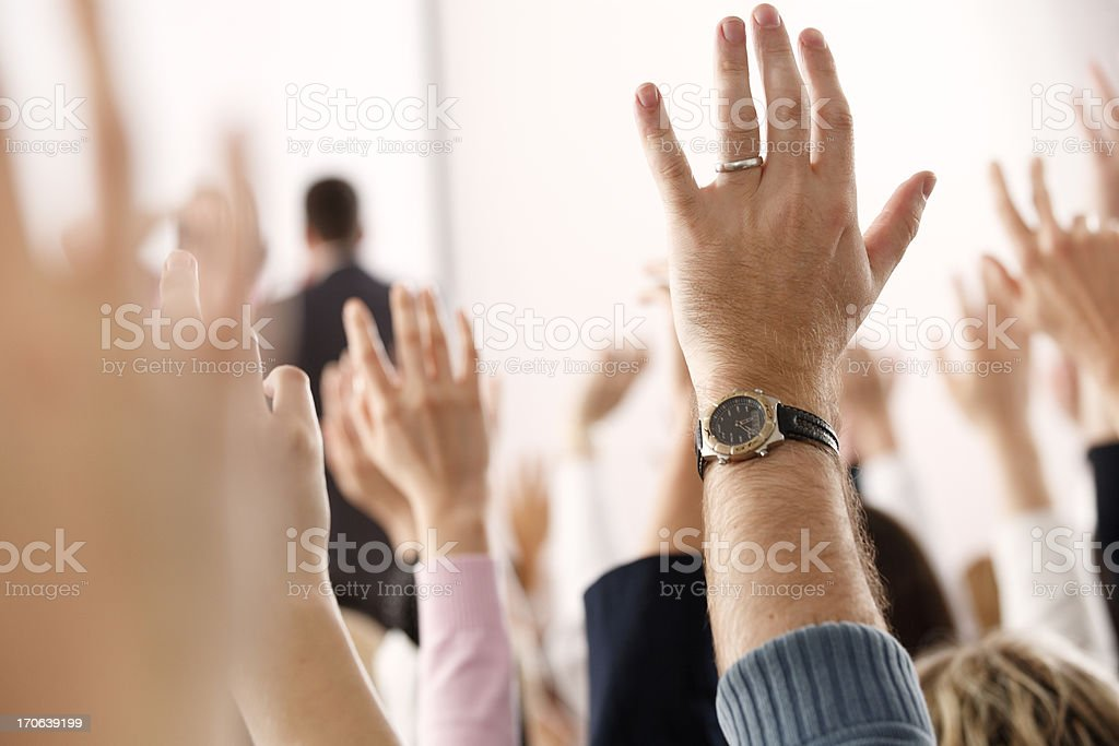 Hands and lecturer royalty-free stock photo
