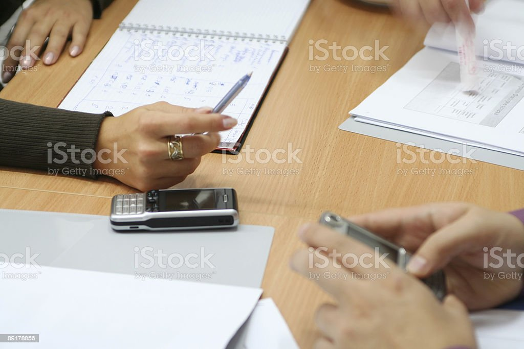 Hands and mobiles in the office royalty-free stock photo