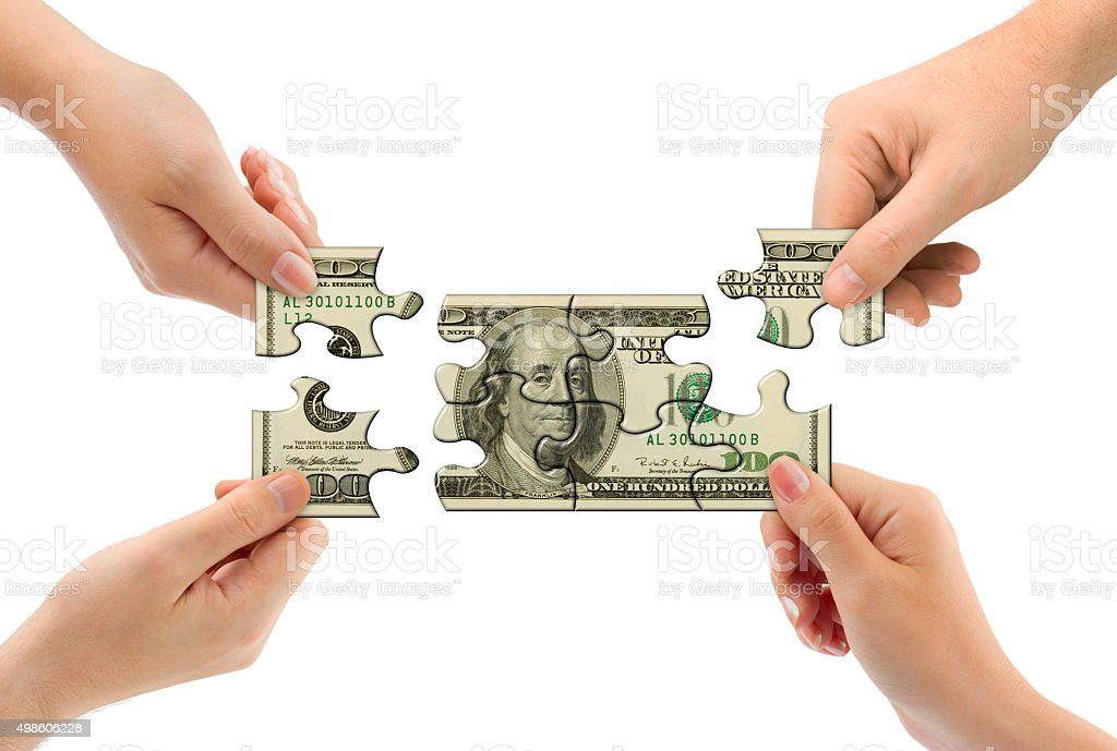 Hands and money puzzle stock photo