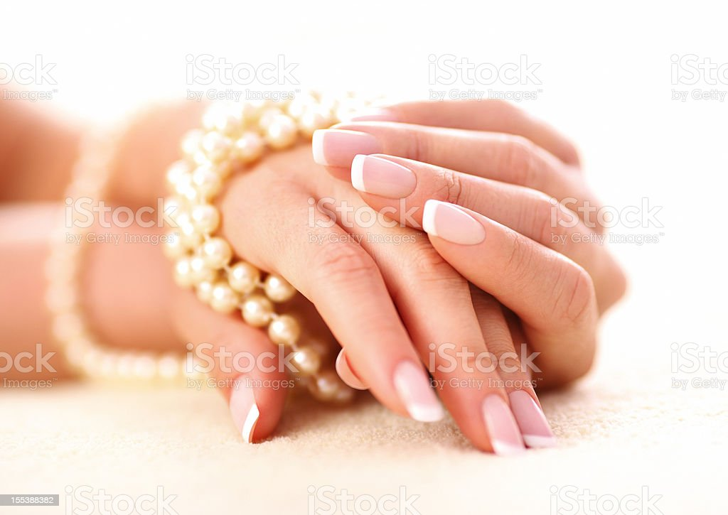 Hands and pearls. stock photo