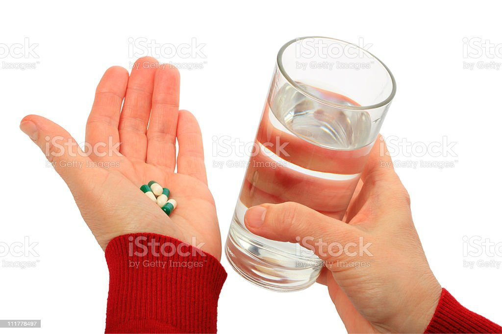 Hands and pill royalty-free stock photo