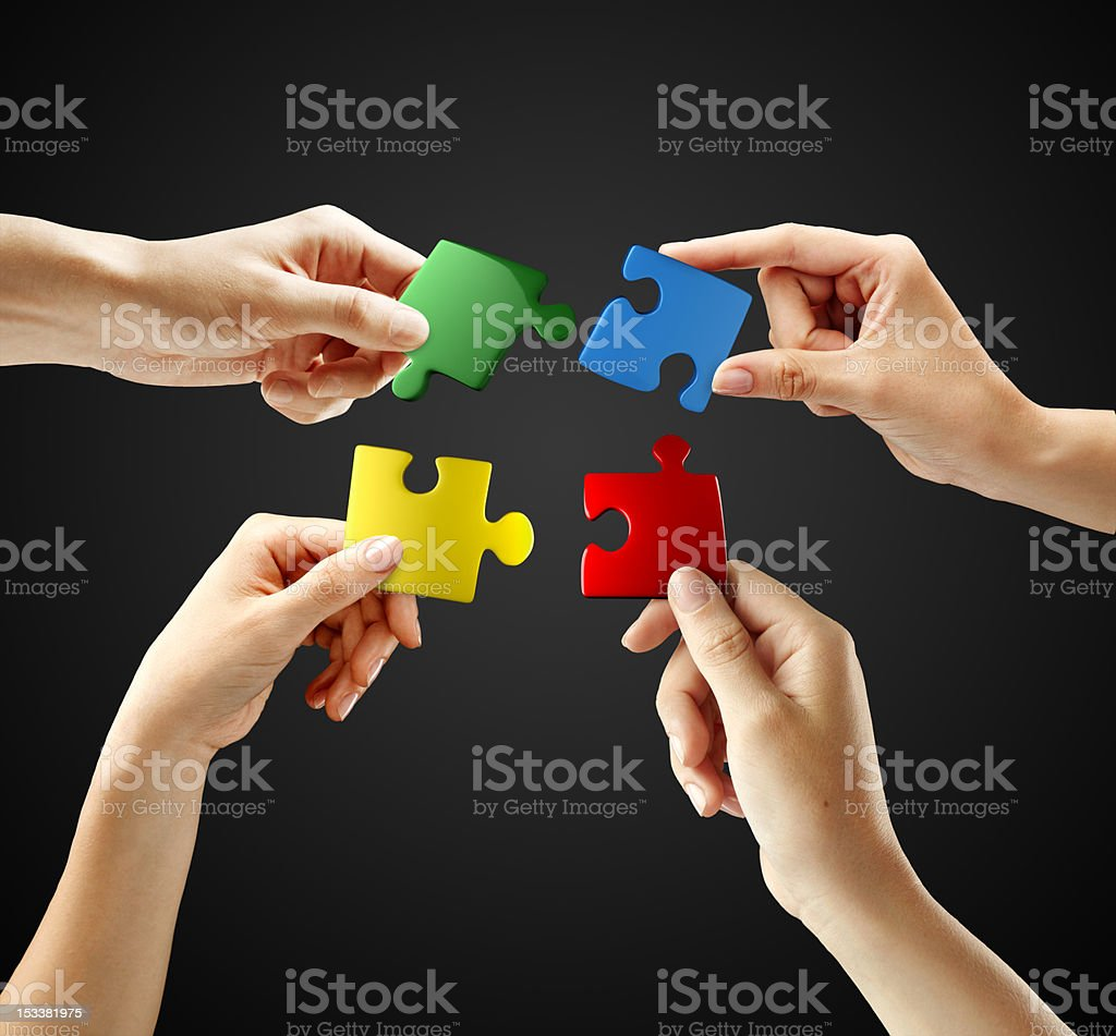 Hands and puzzle on gray background royalty-free stock photo
