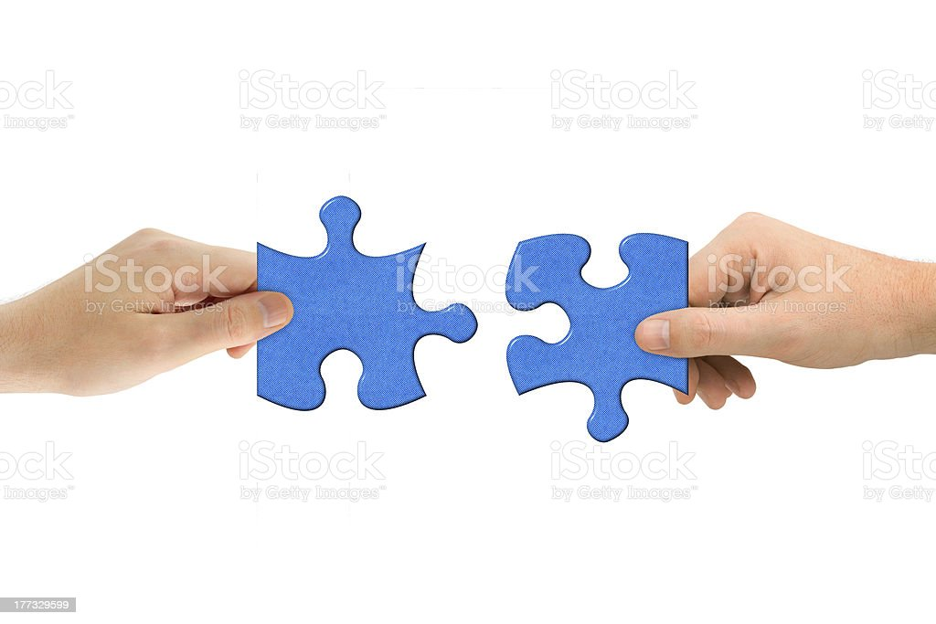Hands and puzzle royalty-free stock photo