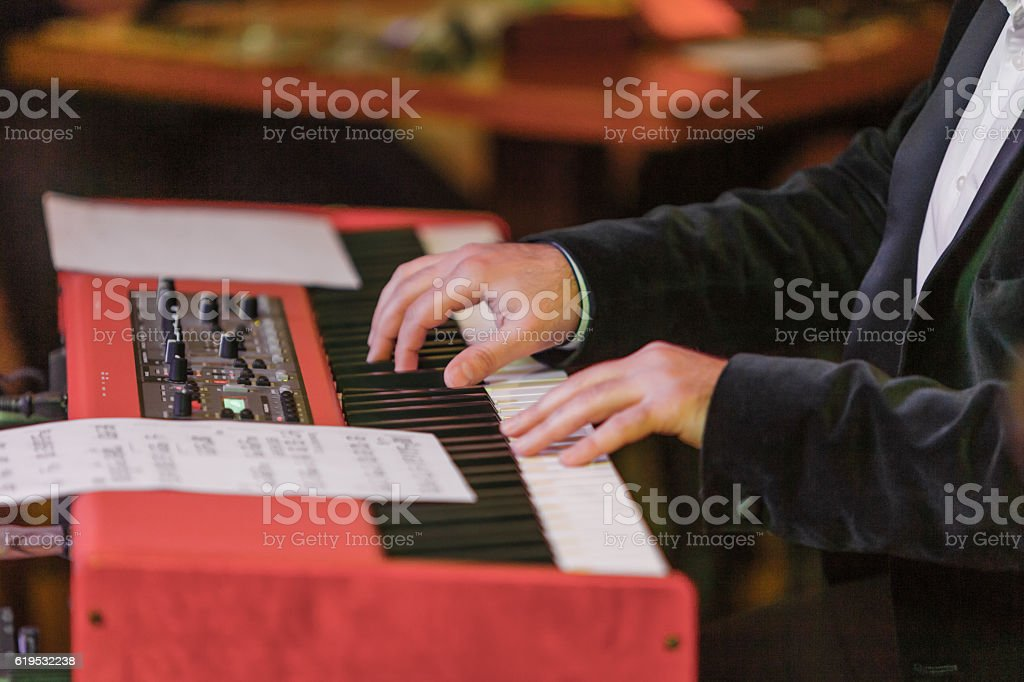 Hands and synthesizer stock photo