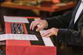 Hands and synthesizer