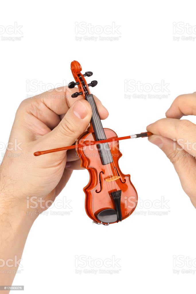 Hands and toy violin stock photo