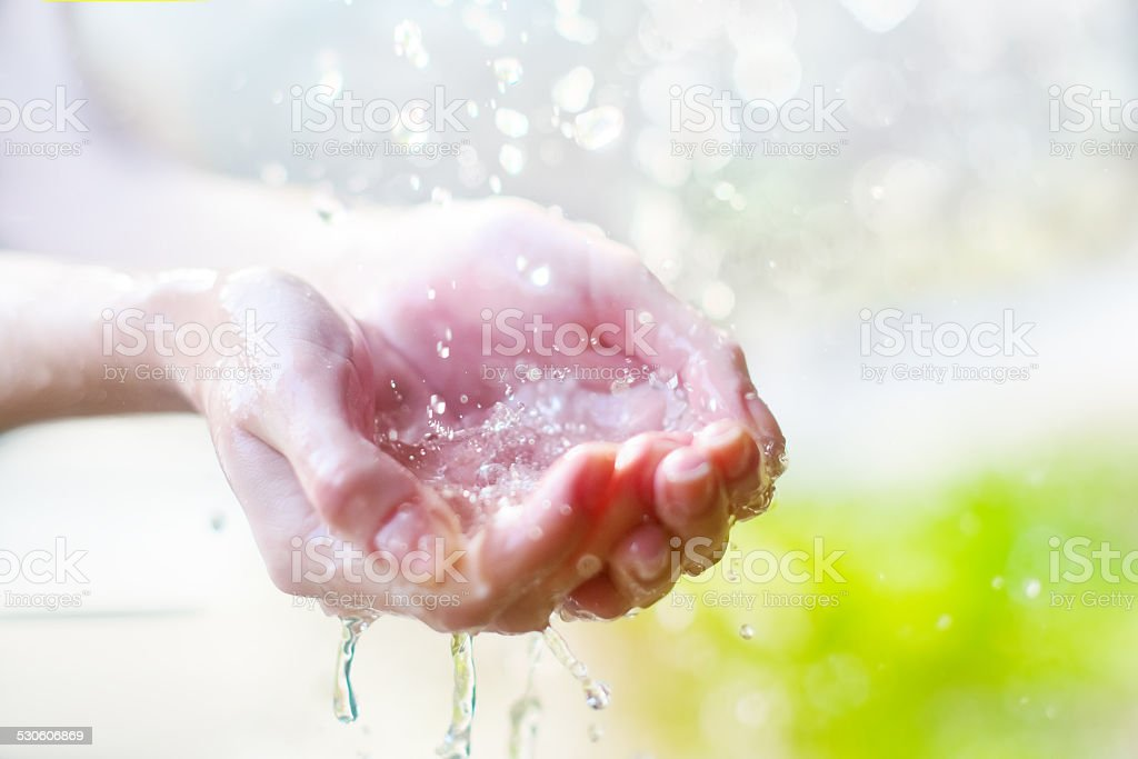Hands and water stock photo