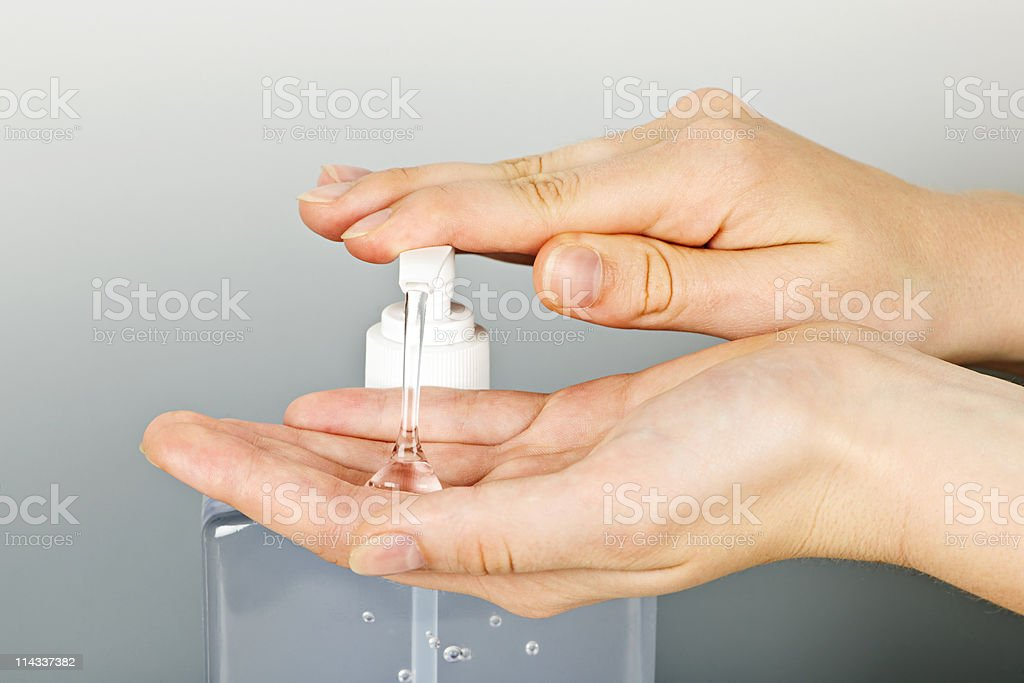 Hands applying germ sanitizer gel stock photo