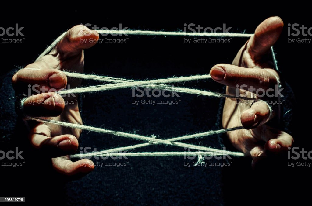 hands are tangled in the thread stock photo