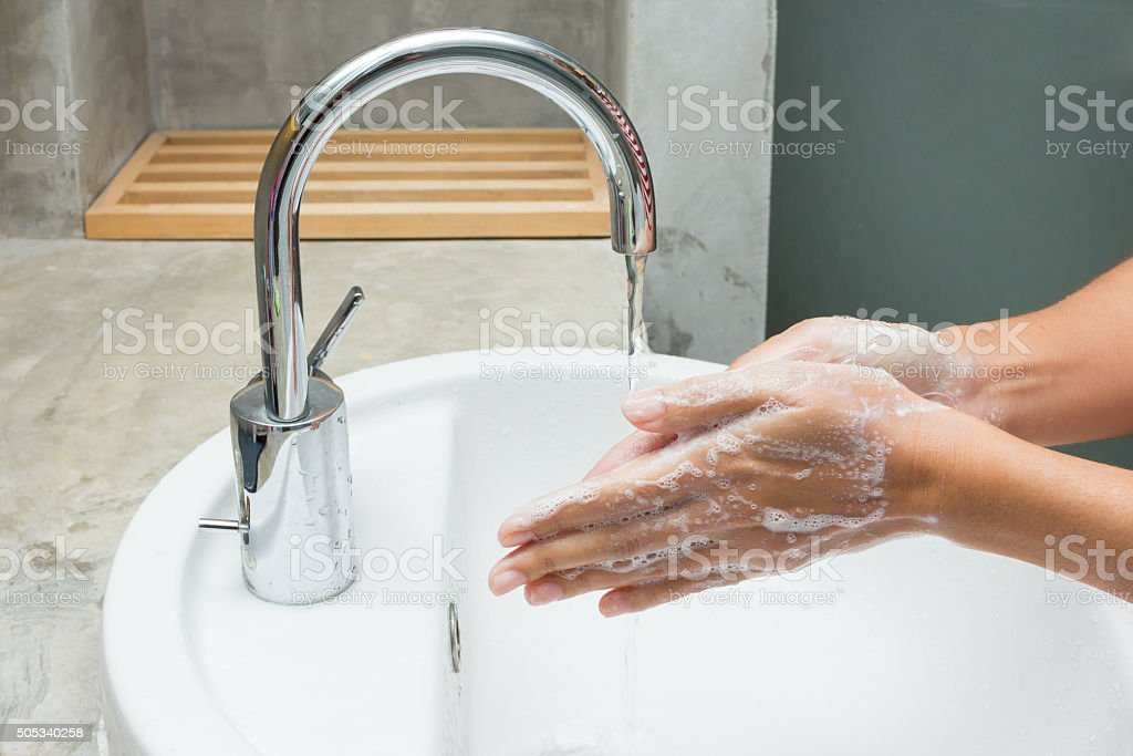 hands being washed with soap stock photo