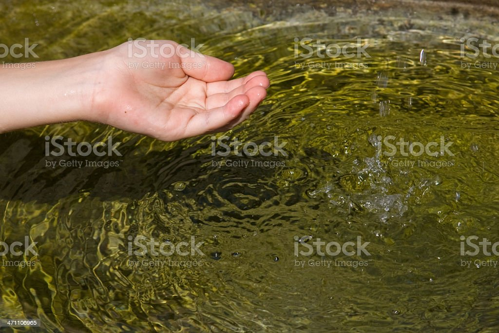 hands catching falling water royalty-free stock photo
