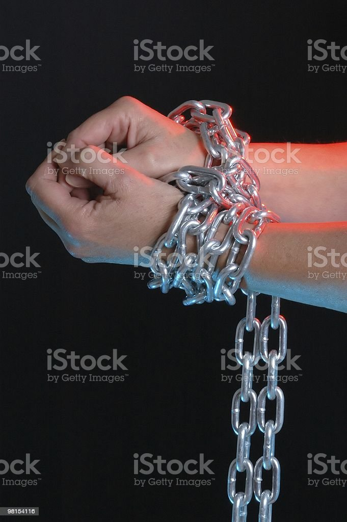 Hands Chained Together stock photo