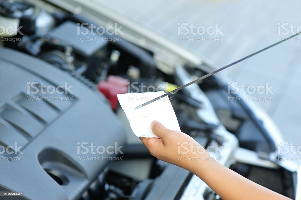 hands checking the car engine oil stock photo