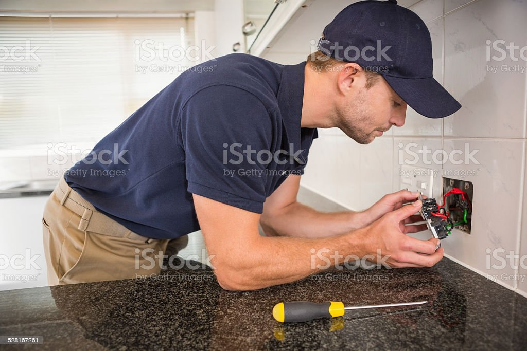 Hands checking the connections of electrical cables stock photo
