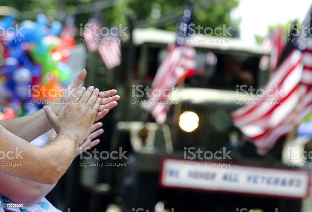 hands clapping at veterans parade stock photo