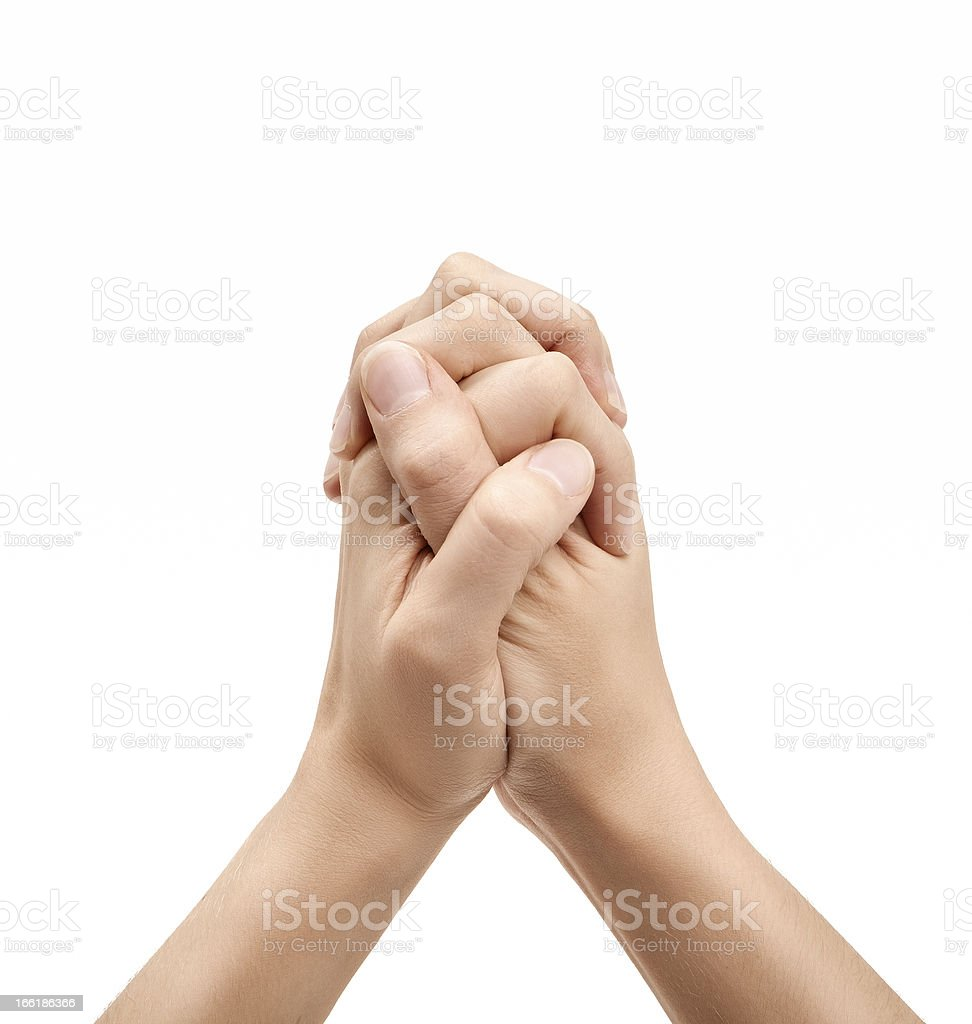 Hands clasped together on white background stock photo