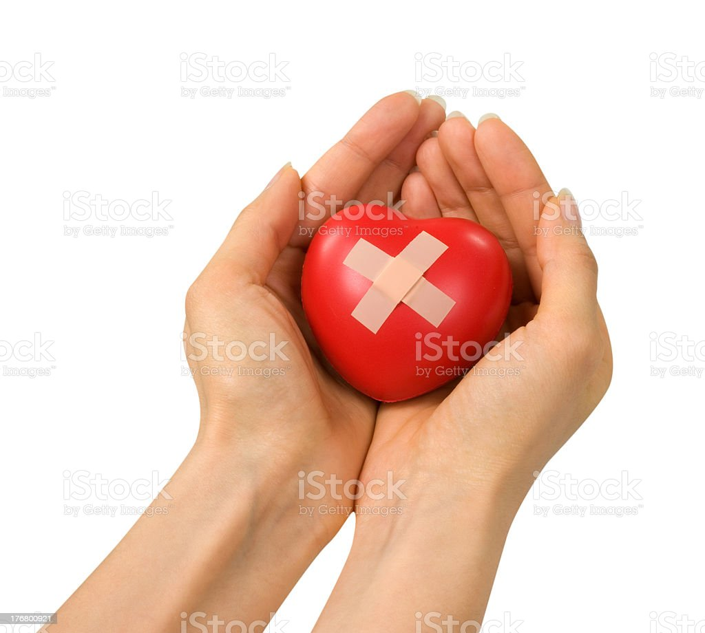Hands clasping a medical heart symbol in its palms royalty-free stock photo