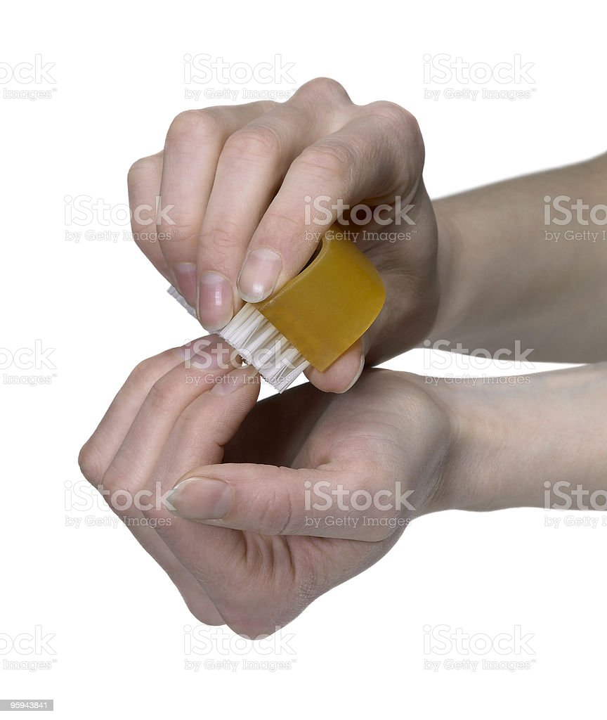 hands cleaning nails with a scrubber royalty-free stock photo