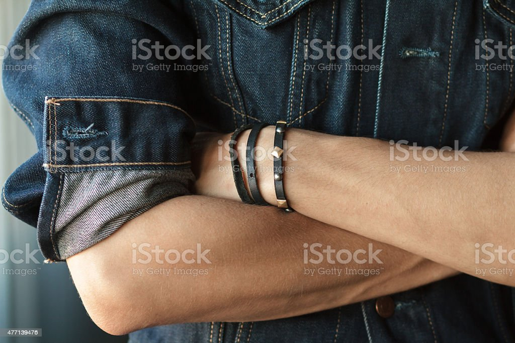 Hands closeup of man in a denim jacket stock photo