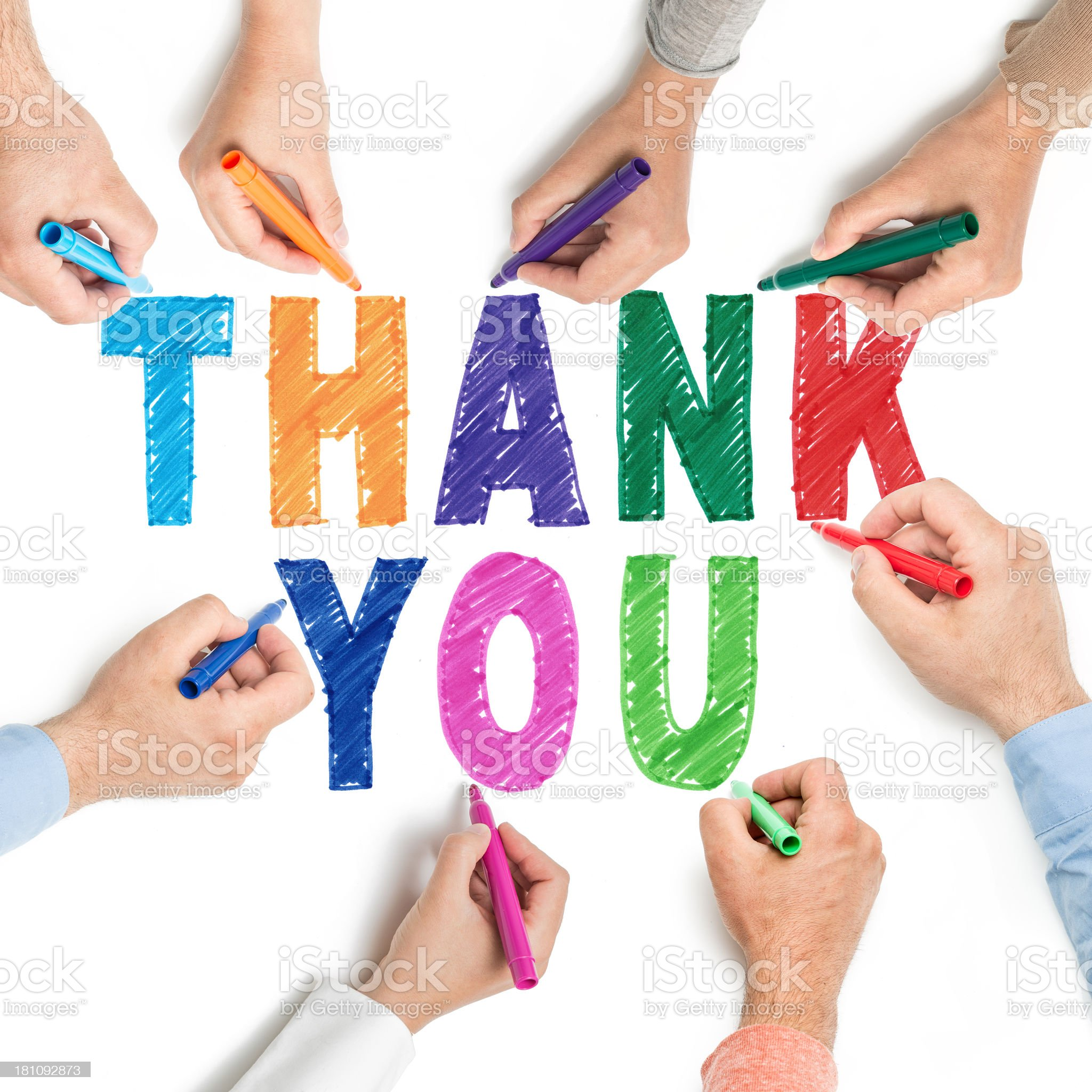 Hands coloring in thank you on whiteboard. royalty-free stock photo