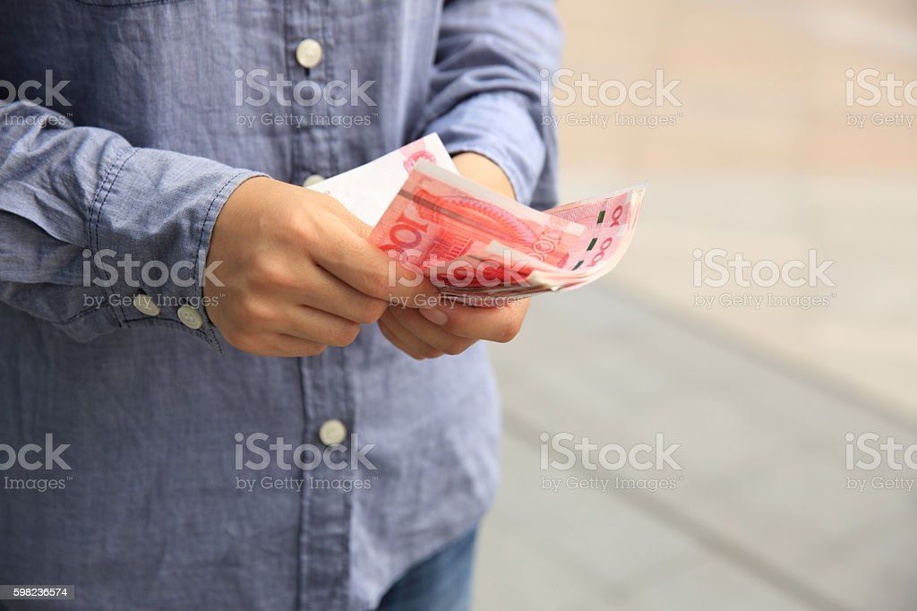 Hands counting chinese yuan money stock photo