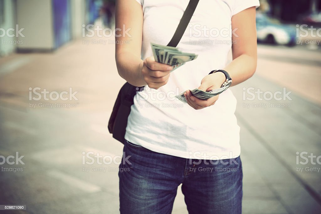 Hands counting  us dollars on the street stock photo