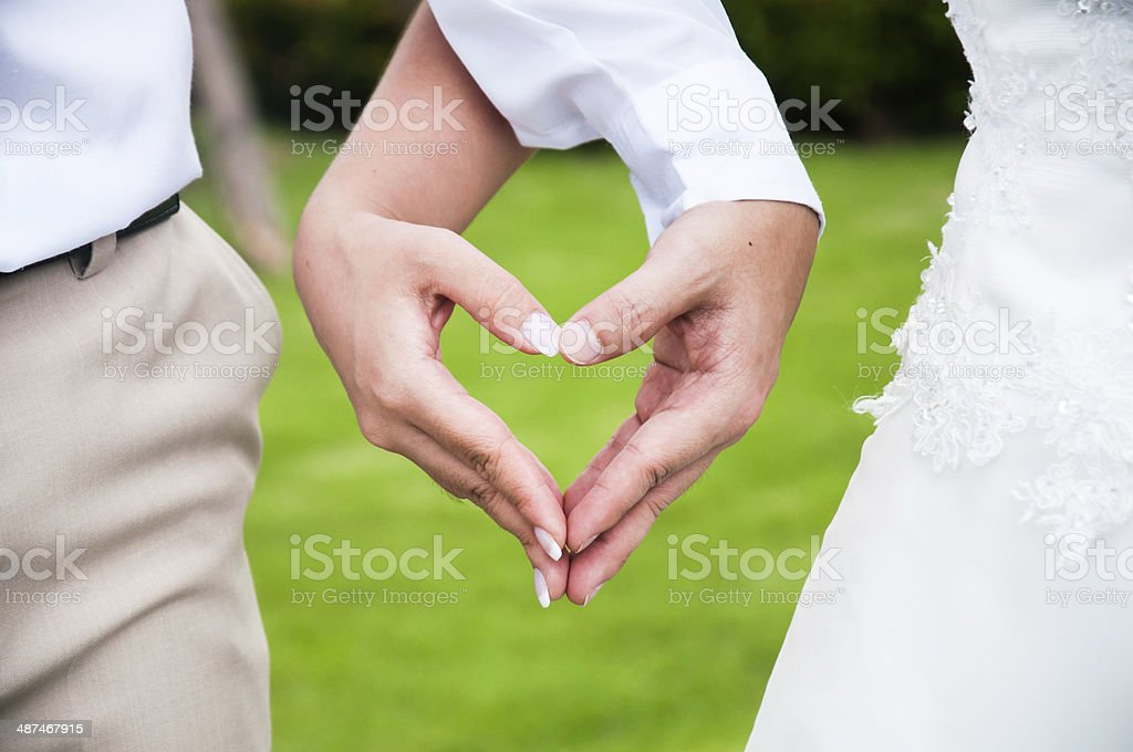 Hand's couple drawing hearts symbol royalty-free stock photo
