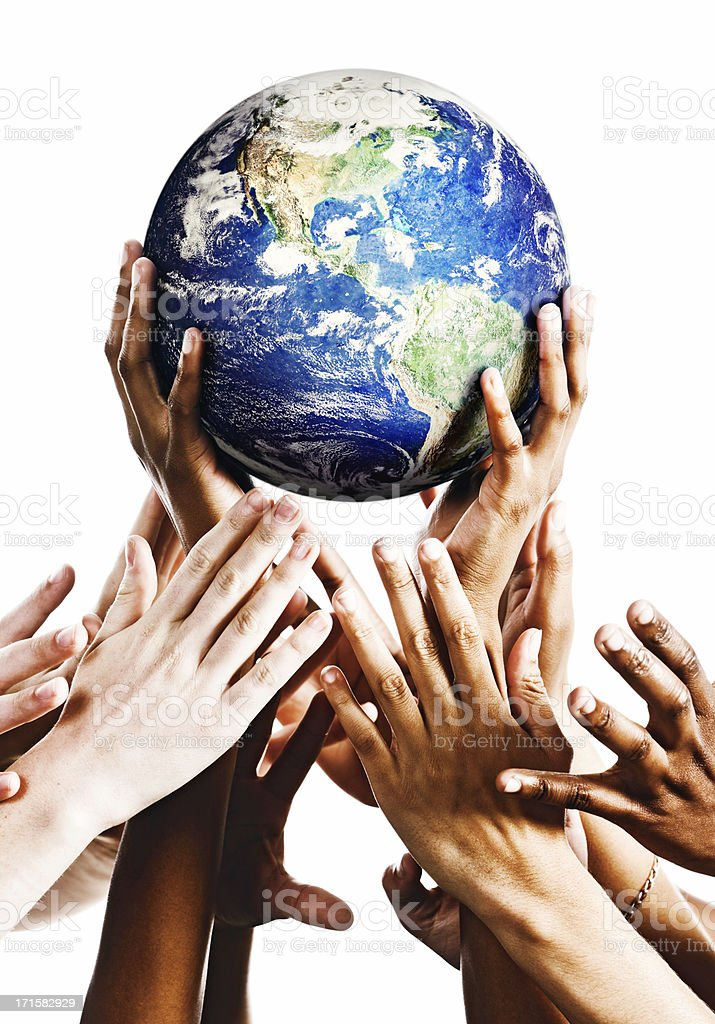 Hands cradling Planet Earth as others try to snatch it stock photo