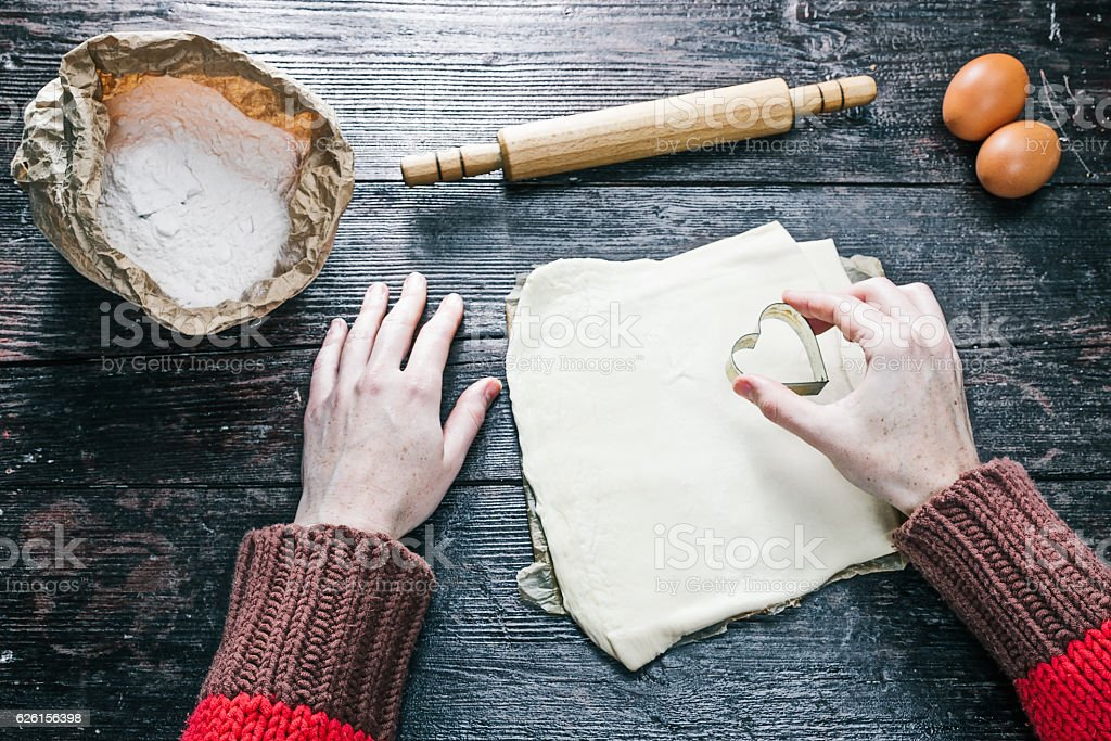 Hands cutting cookies stock photo