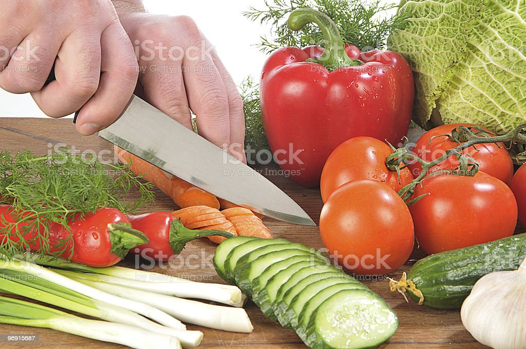 Hands cutting vegetables stock photo