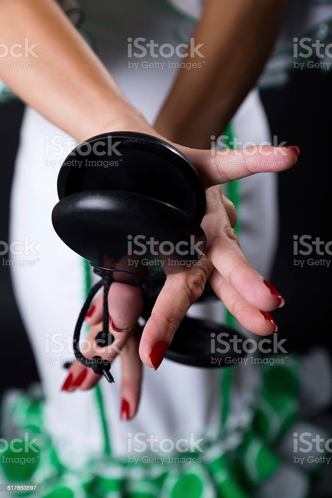 Hands detail of flamenco dancer on black background stock photo