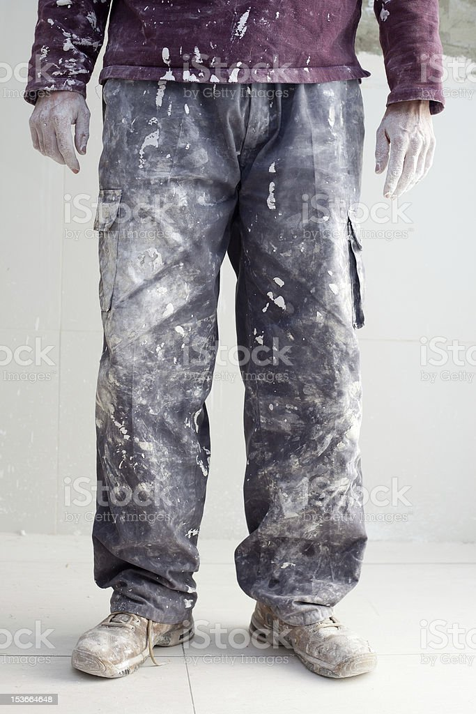 hands dirty trousers of plastering painter man royalty-free stock photo