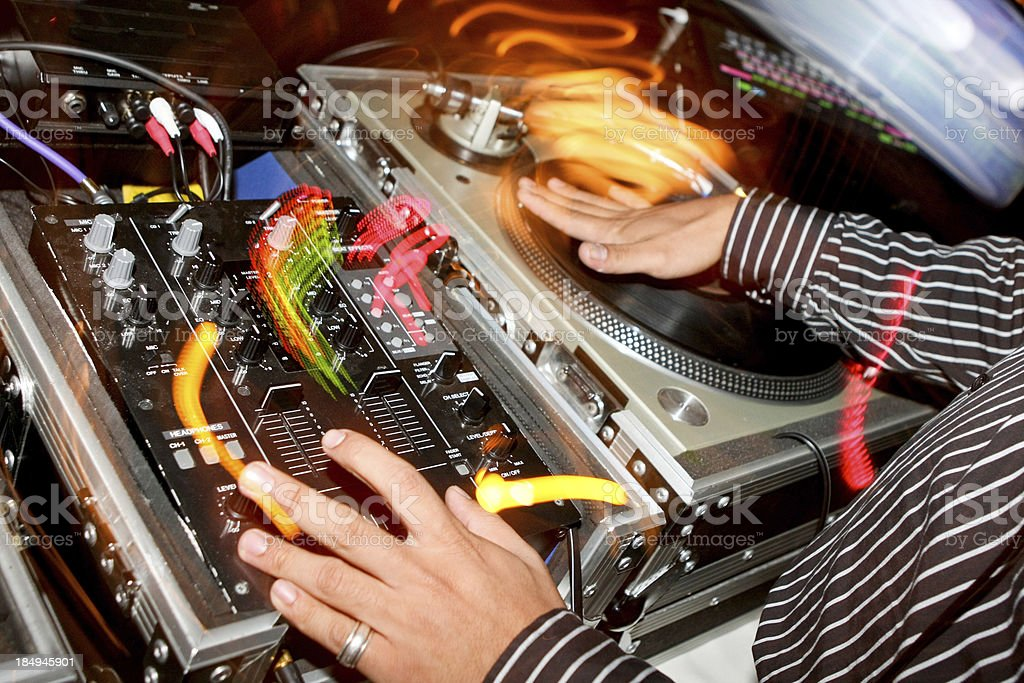 Hands DJ playing on vinyl in nightclub royalty-free stock photo