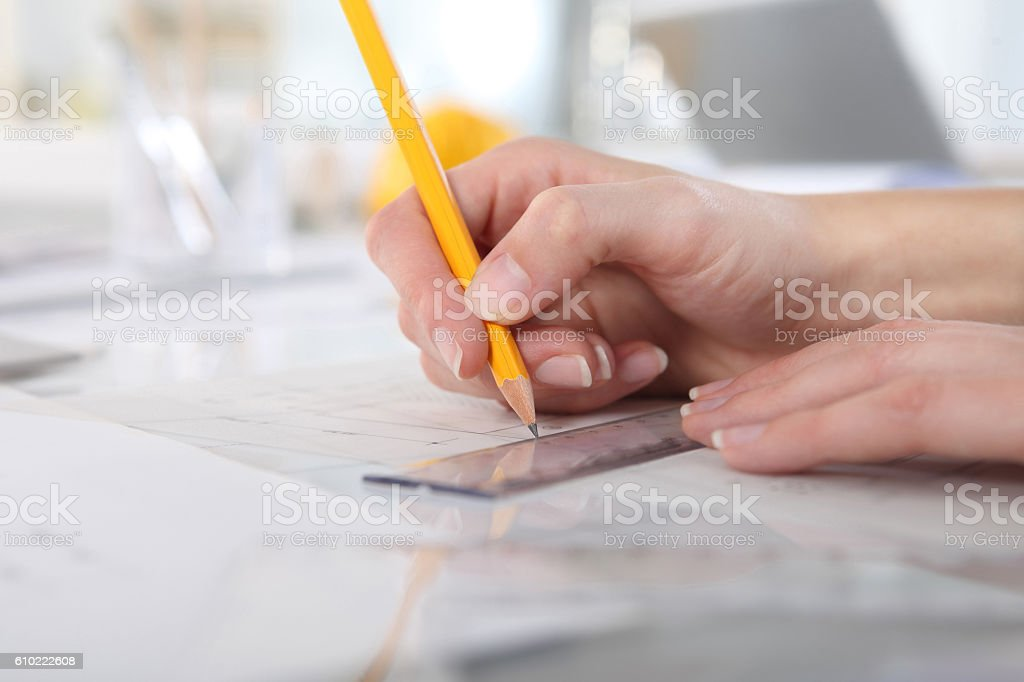 hands drawing with pencil and ruler, close up stock photo