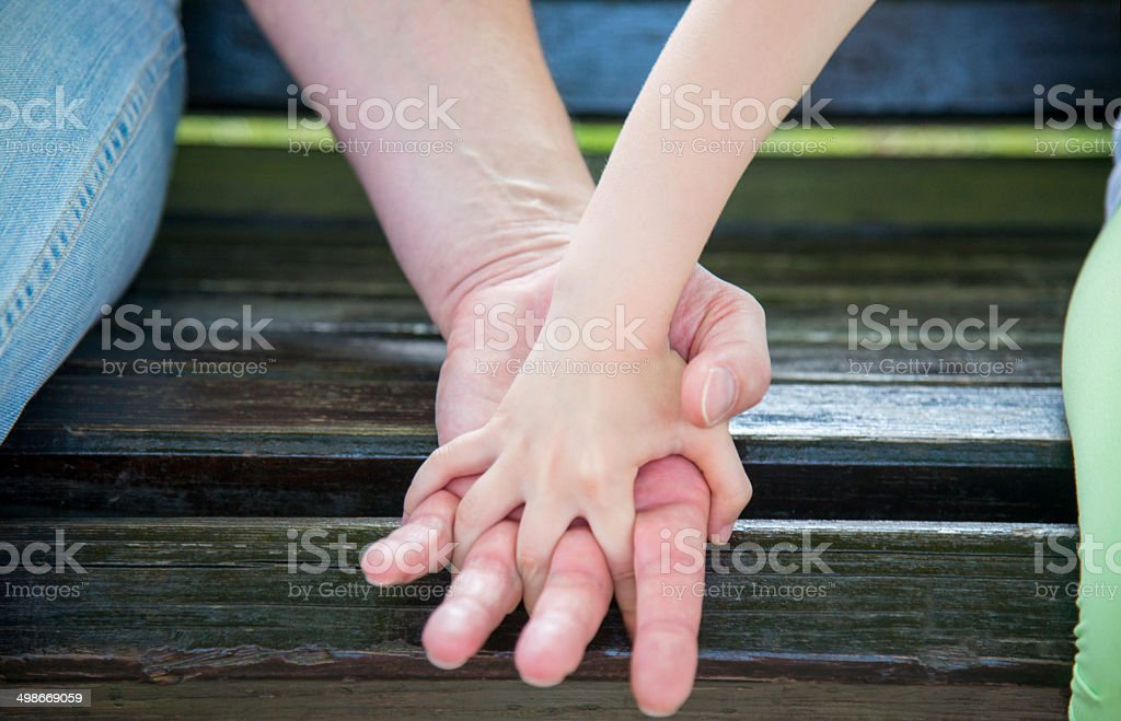 Hands  father and daughter stock photo