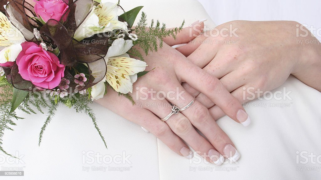 Hands folded over a lovers sholders royalty-free stock photo