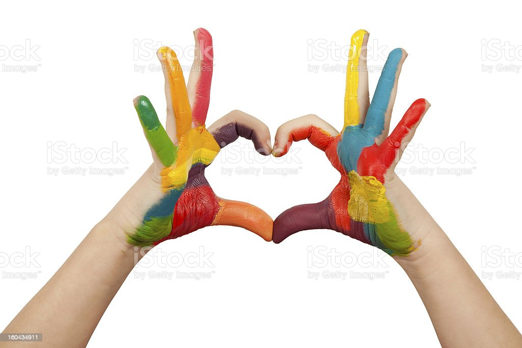 Hands forming a heart shape painted in multiple colors stock photo