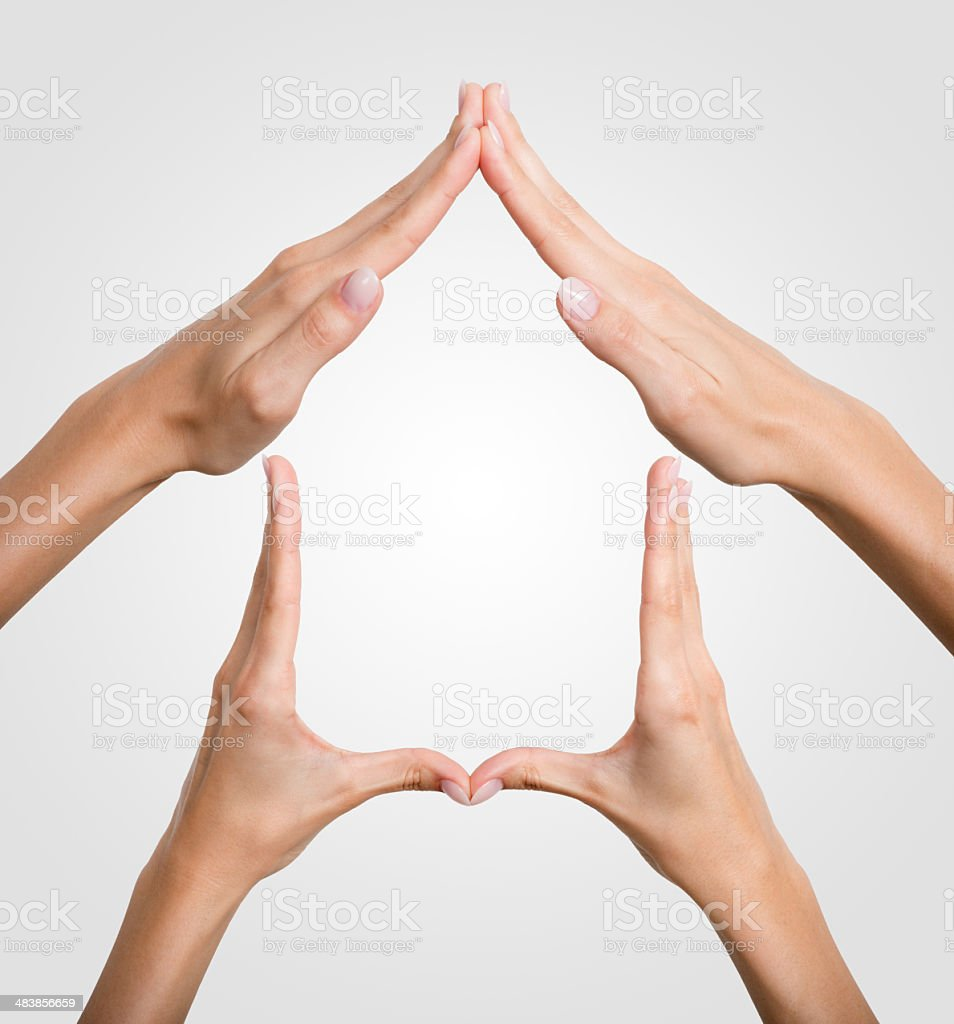 Hands forming a House, Symbol, Sign stock photo