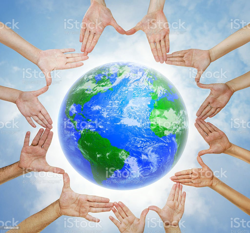 Hands forming circle with planet Earth in center stock photo