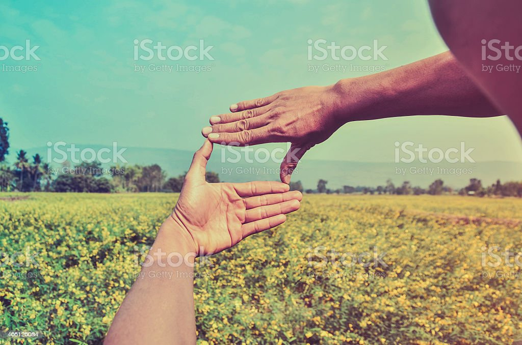 Hands framing distant stock photo