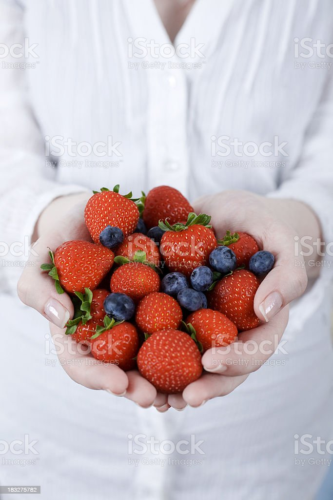 Hands full of blueberries royalty-free stock photo