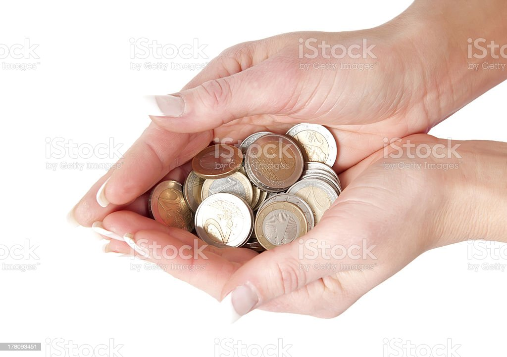 hands full of coins stock photo