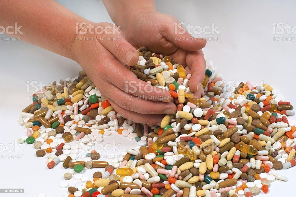 hands full of drugs stock photo
