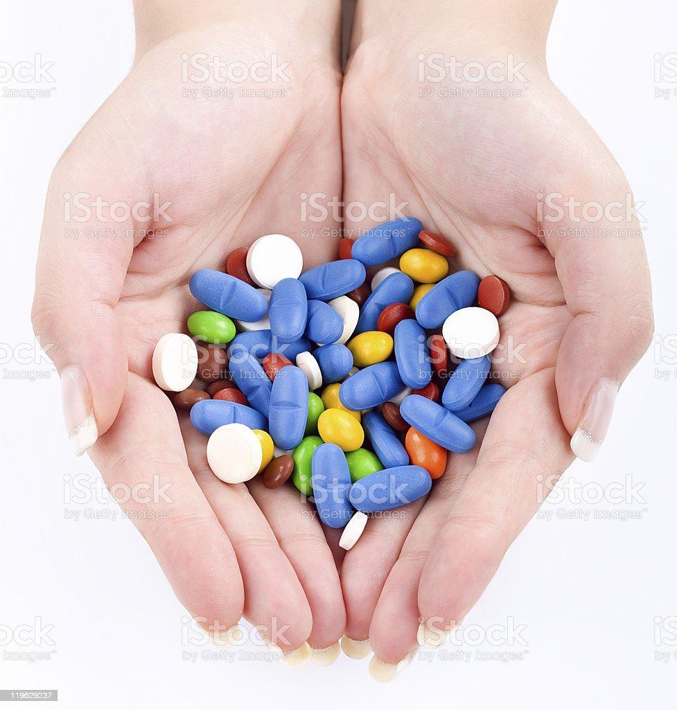 Hands full of pills stock photo