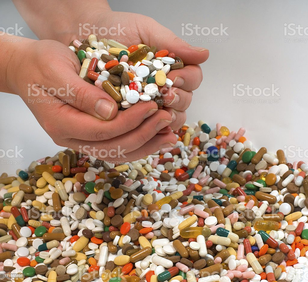 hands full of tablets stock photo